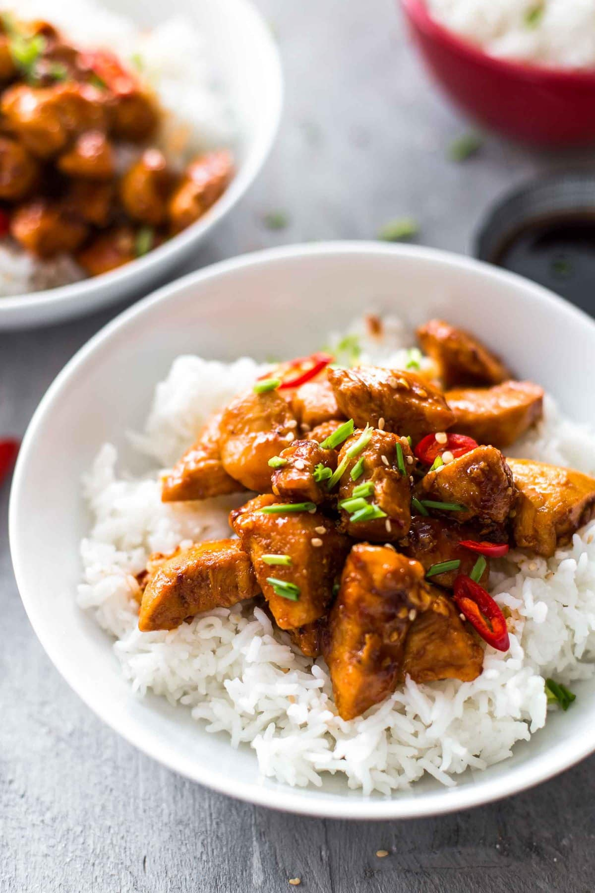 a bowl of white rice and bourbon chicken