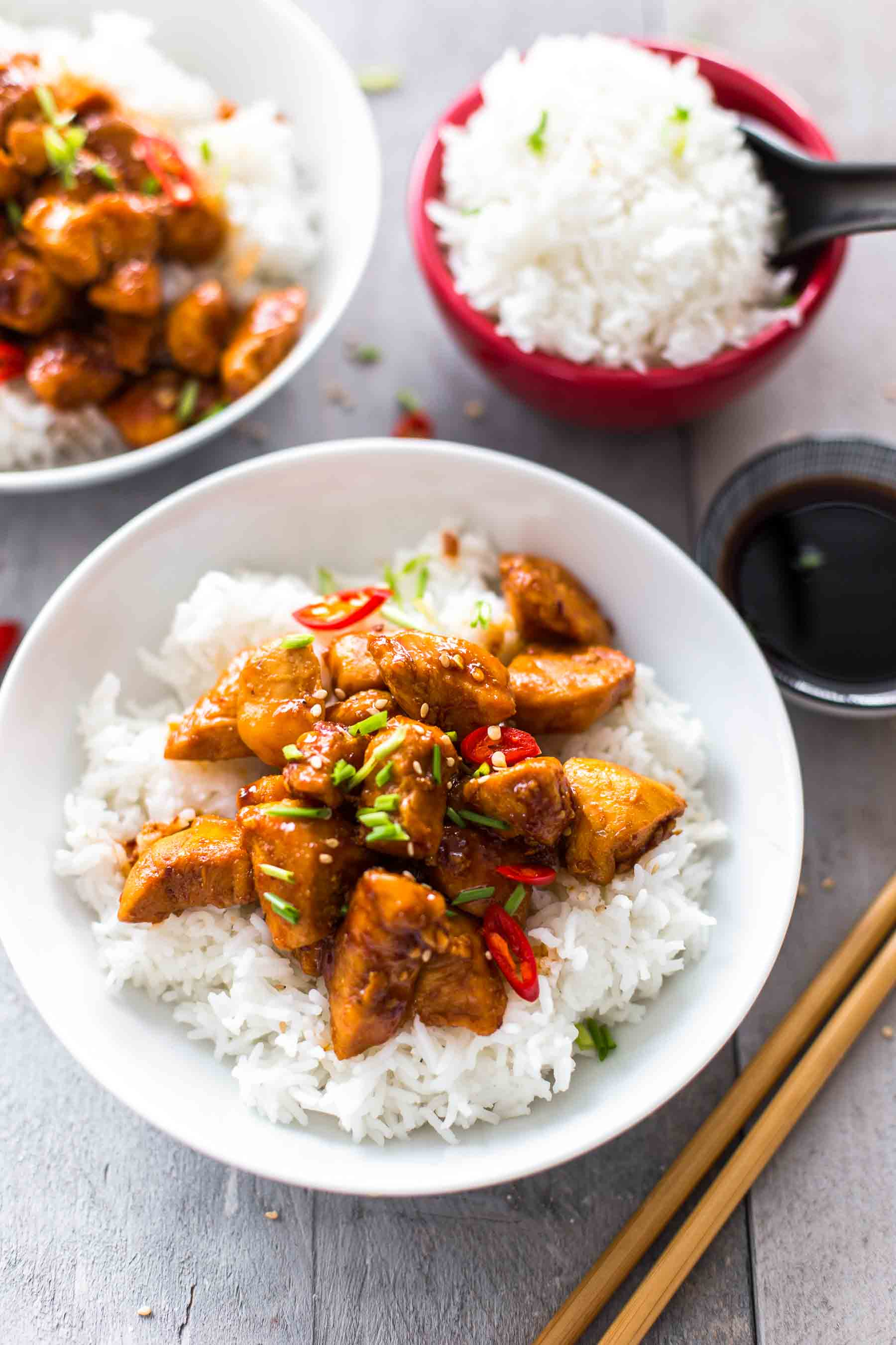 bowls of bourbon chicken with rice