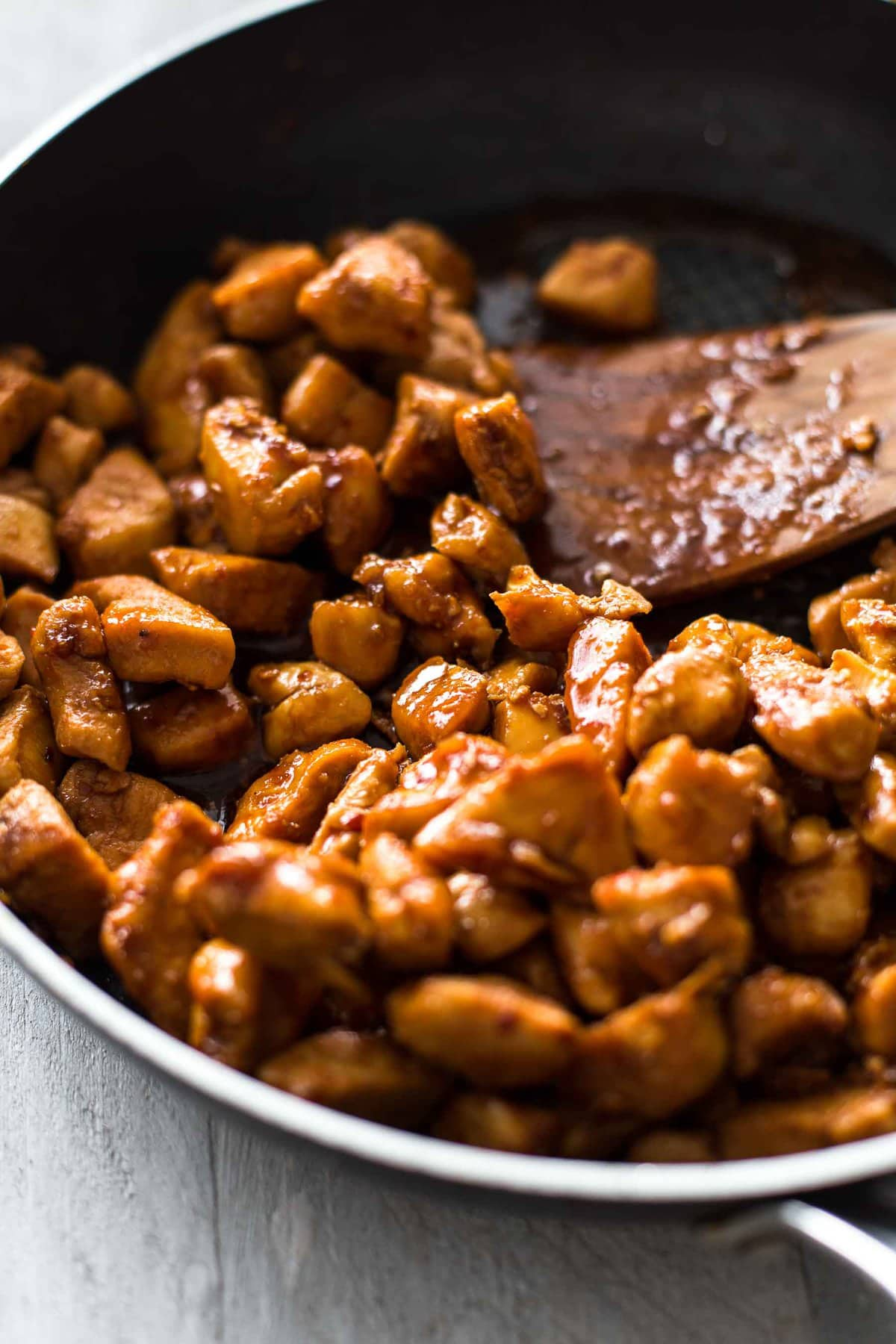 cooking bourbon chicken in a skillet