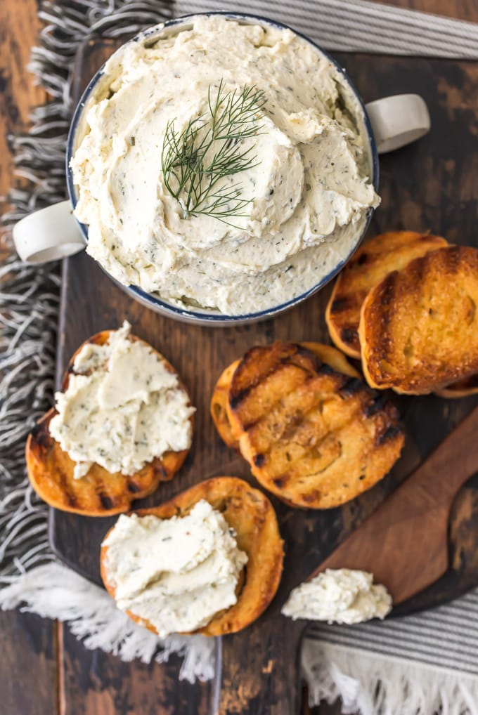 Boursin Cheese is a soft, creamy cheese that works as a dip or a spread. It's the perfect appetizer to serve with vegetables and crackers, or you can add it into salads, pastas, chicken recipes, or even bake with it. This herb-filled, flavorful homemade Boursin Cheese recipe goes well with just about everything! So whip some up and serve it at your next party.