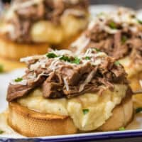 open faced roast beef sandwiches on a plate