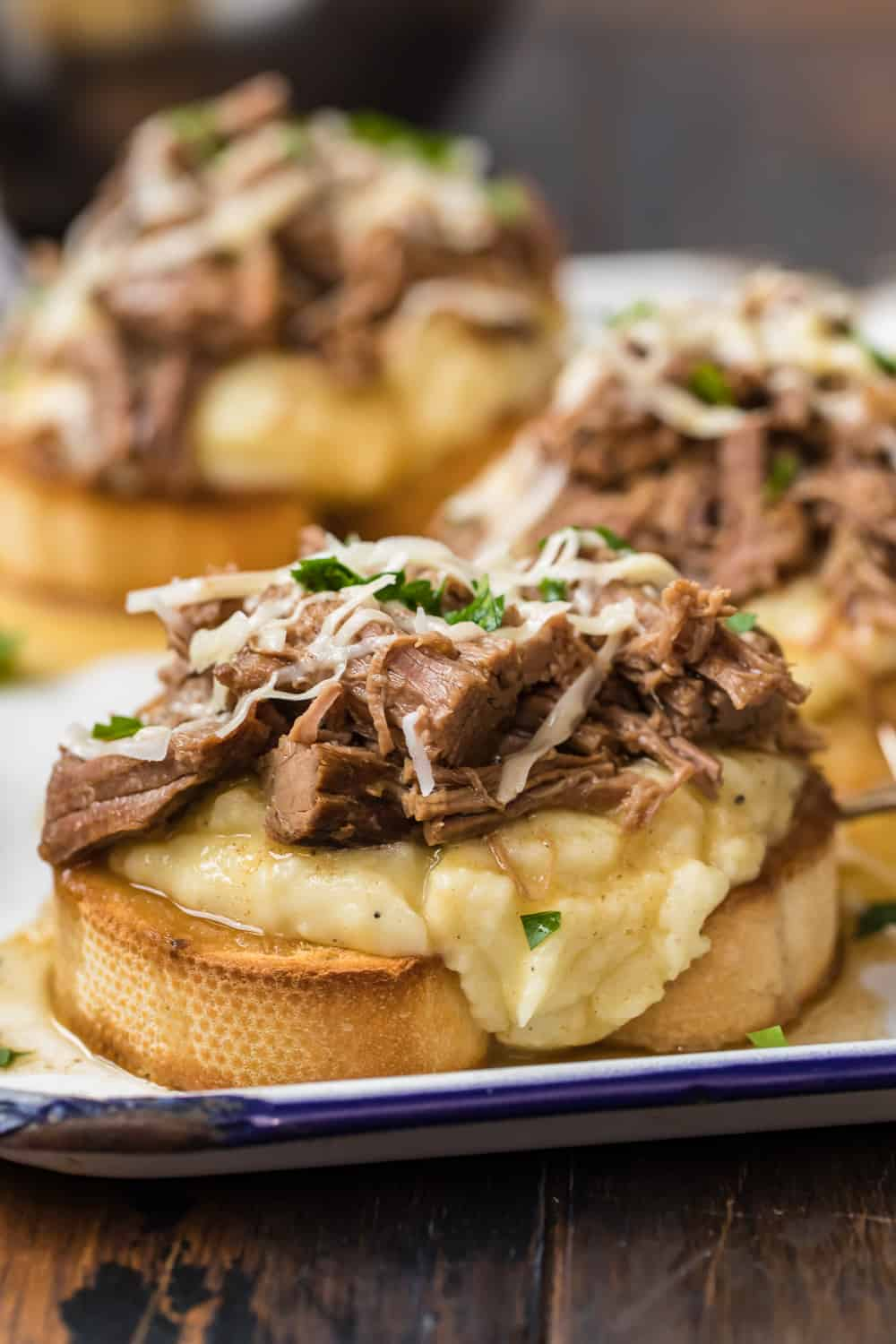 Open Faced Roast Beef Sandwich on a blue and white plate.