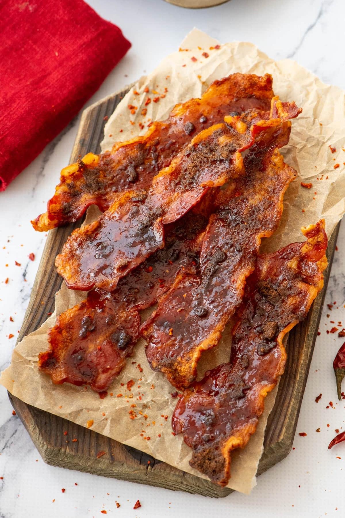 strips of bacon on a wood board