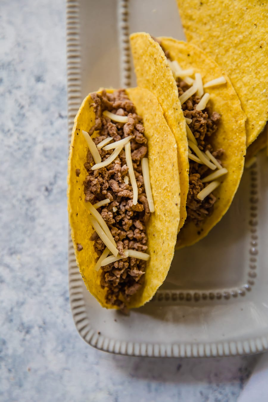 taco shells filled with boiled ground beef crumbles