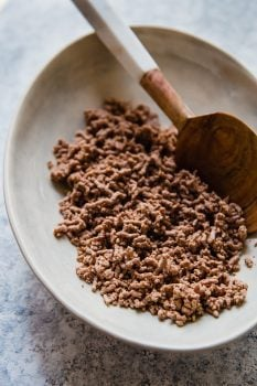 Wondering how to cook ground beef? Frying is a popular option, but boiling ground beef is easy, quick, and it creates leaner meat! Cooking ground beef with this method creates the perfect crumbled ground beef for tacos, chili, spaghetti sauce, and more.