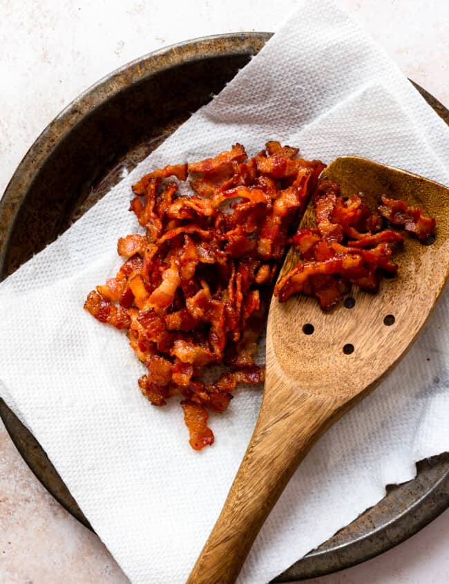 bacon crumbles with wooden spoon