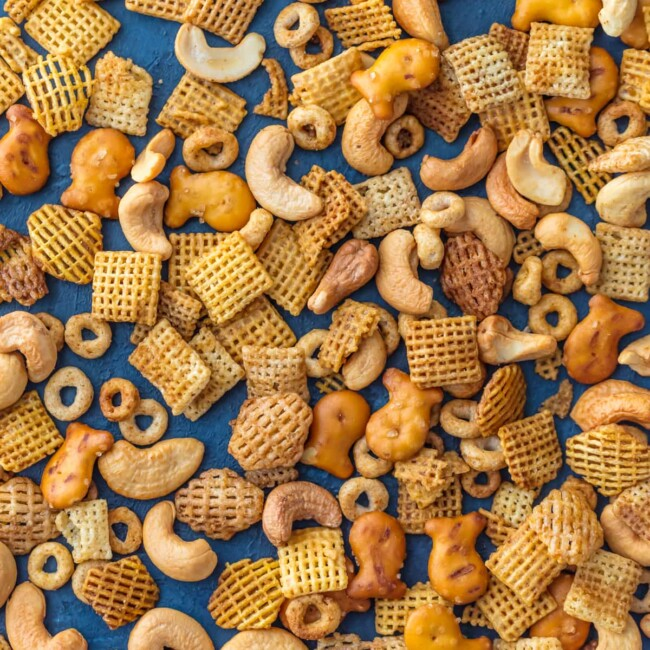 Chex Mix Recipe is a recipe my Mom has been making since I was a little kid. It's our family's favorite BESTChex Party Mix! It doesn't get better than this mix of cereal, nuts, pretzels, and all that spice! A little bit sweet and little bit spicy. This BEST EVER Chex Party Mix Recipeis perfect for Christmas, tailgating, Summer BBQs, and every day in between. SO ADDICTING!
