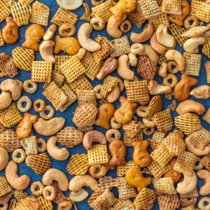 Chex Party Mix is a recipe my Mom has been making since I was a little kid. It's our family's favorite Chex Mix Recipe! It doesn't get better than this mix of cereal, nuts, pretzels, and all that spice! A little bit sweet and little bit spicy. This BEST EVER Chex Party Mix Recipe is perfect for Christmas, tailgating, Summer BBQs, and every day in between. SO ADDICTING!
