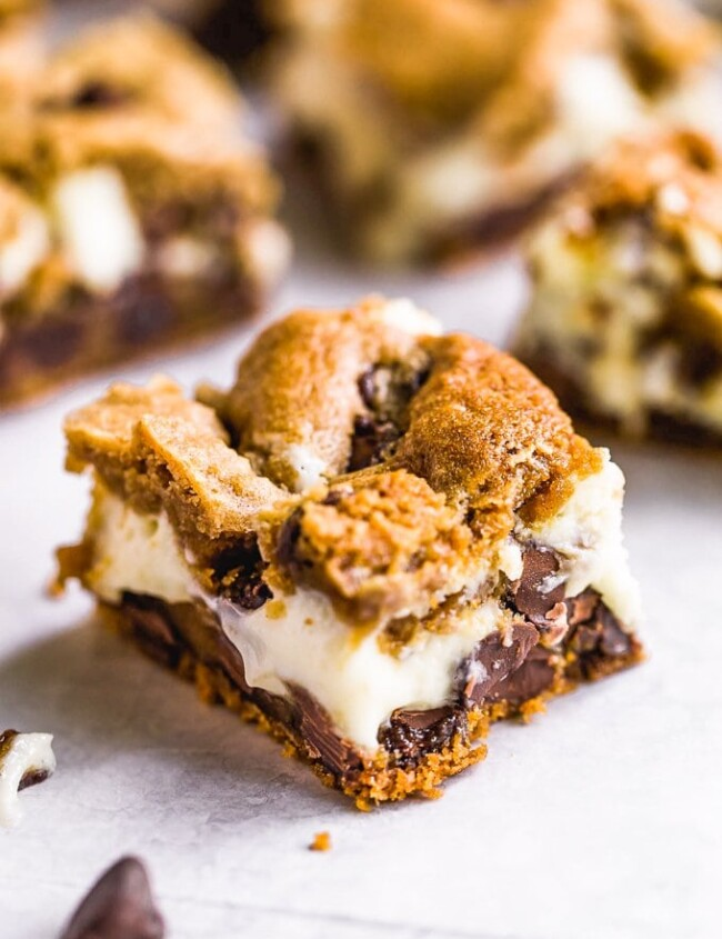 Chocolate Chip Cheesecake Bars are a creamy, chocolaty dessert perfect for game day or just for after dinner. This cheesecake bars recipe is easy to make and oh so yummy!