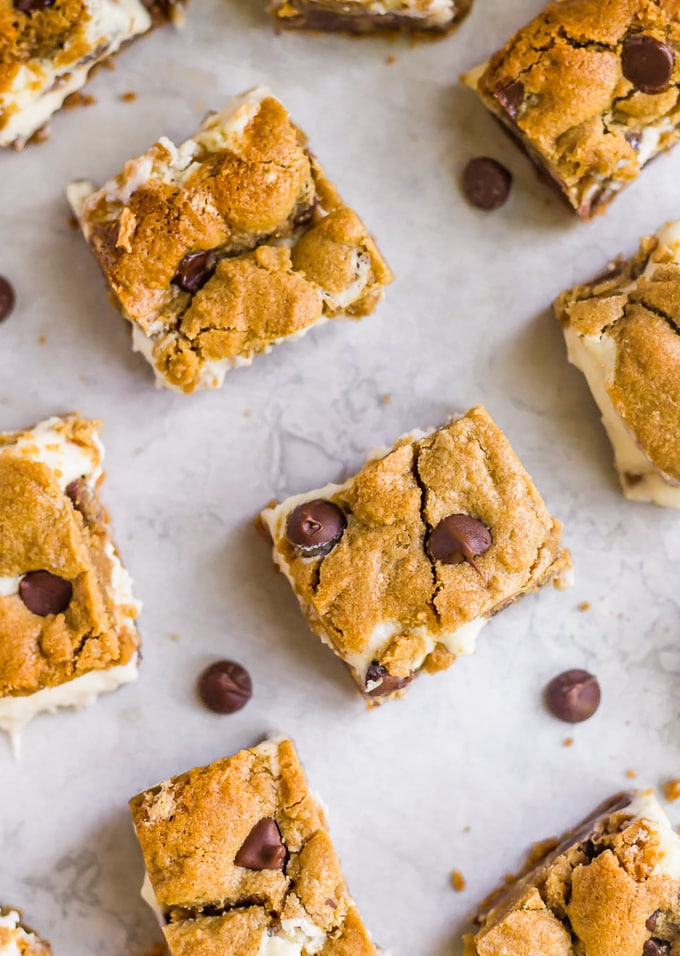 Peanut butter chocolate chip cookie bars with cheesecake filling