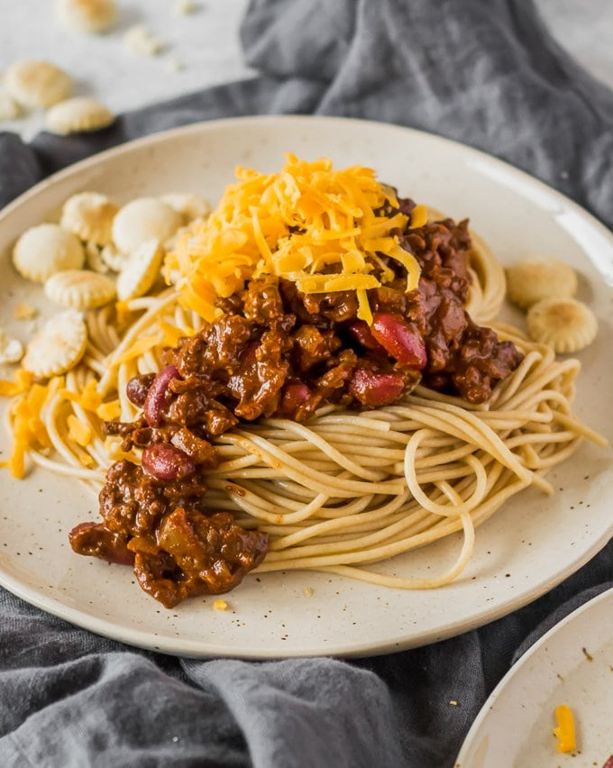 Close up of Cincinnati Chili with cheese and oyster crackers