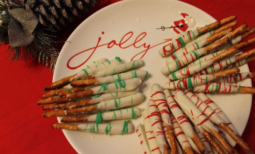 Chocolate Covered Pretzel Sticks on a white plate