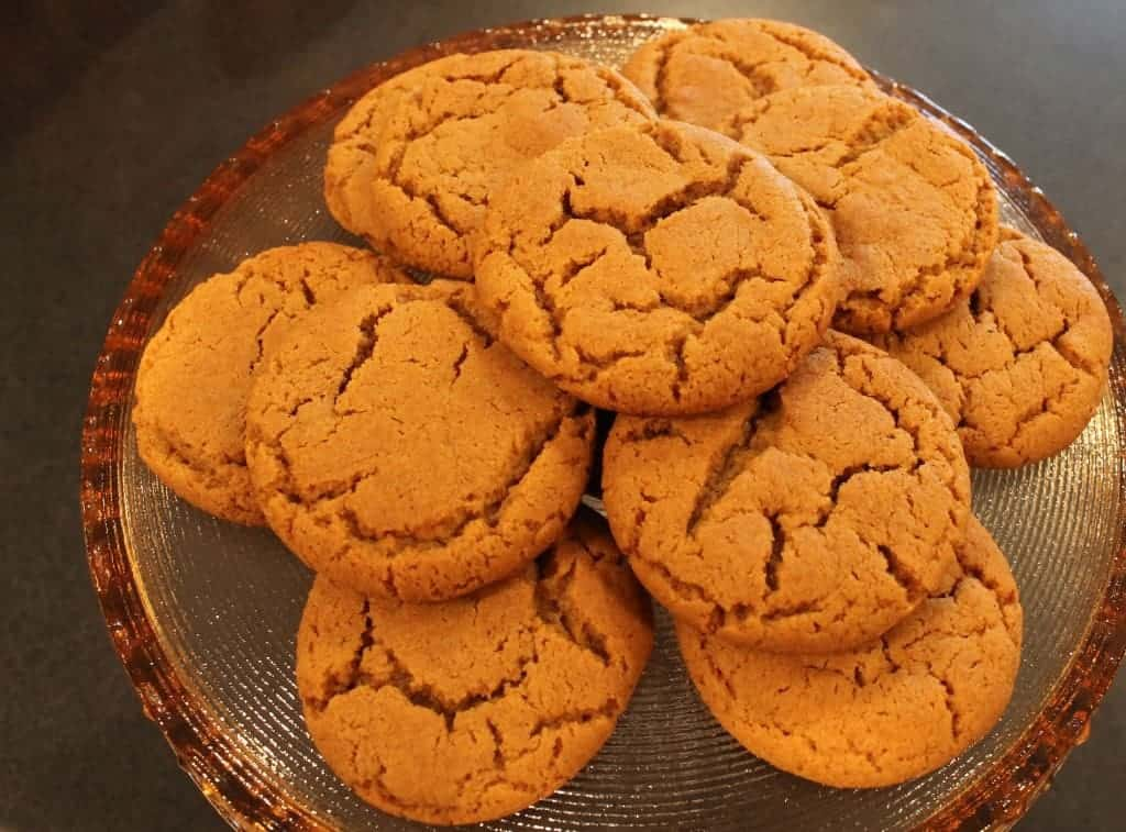 molasses cookies on a cake plate
