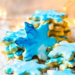 Christmas Butter Cookies with Powdered Sugar Icing are a MUST for the holidays. Simple iced cookies are one of the best treats for Christmas, and this easy butter cookies recipe is my FAVORITE. Make your favorite shapes with cookie cutters, and decorate however you like using our powdered sugar icing recipe!