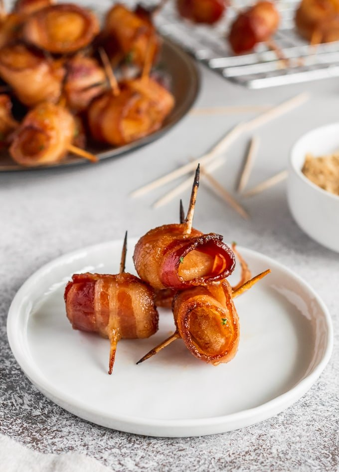 three water chestnuts wrapped in bacon