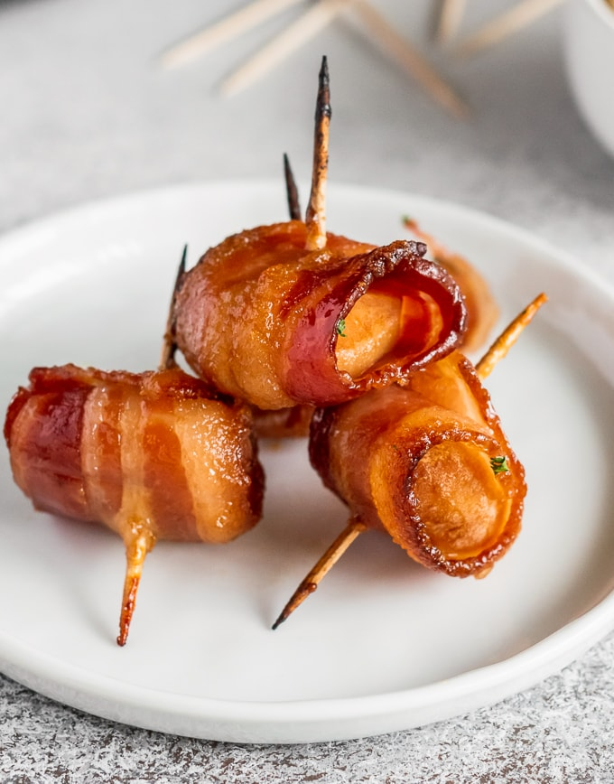 a plate of bacon wrapped water chestnuts