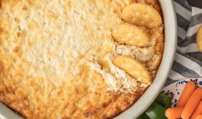 HOT ONION DIP has been a family favorite for years. I just love the sweet, cheesy onion flavor. You really can't do better than a classichot onion dip recipe for the holidays or game day. It's perfect for dipping and oh so yummy. This is the BEST hot onion souffle dip recipe around!