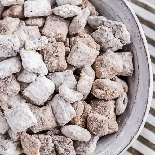 Puppy Chow is a chocolate-y treat that's sure to please! This easy puppy chow recipe includes an original version AND a mint chocolate puppy chow version. Find out how to make puppy chow for a simple yet delicious holiday treat!