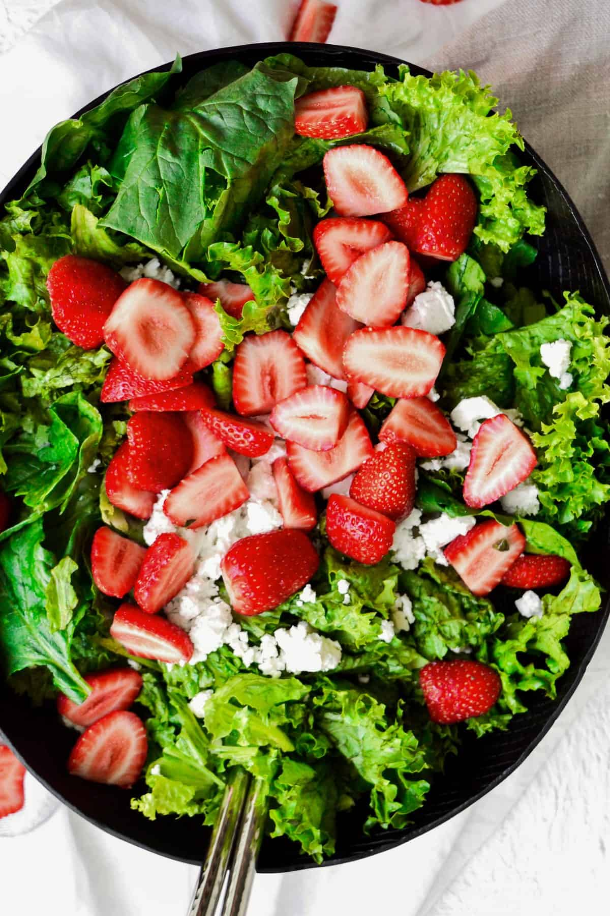 salad topped with strawberry and feta
