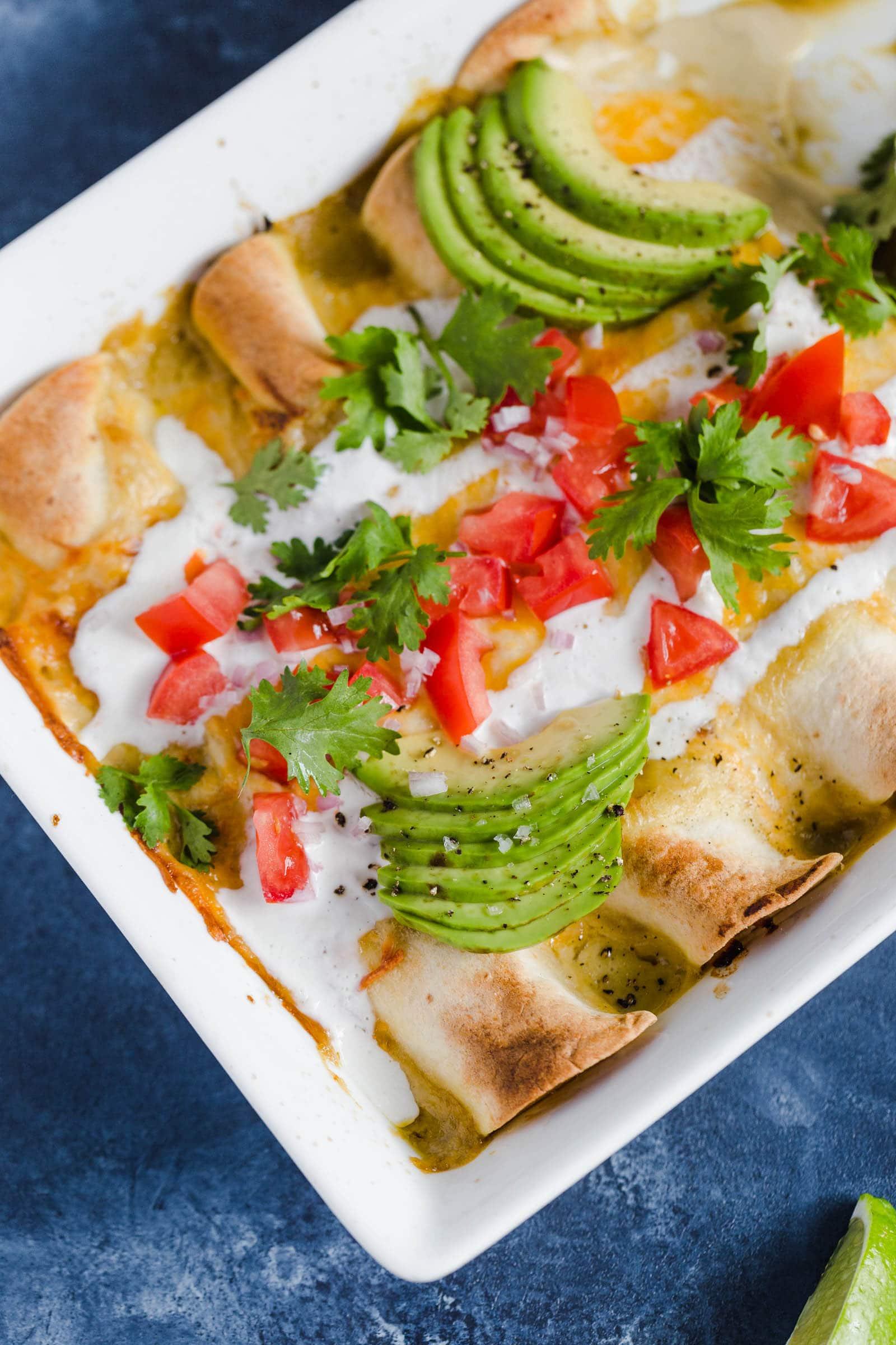 A baking dish of chicken enchiladas