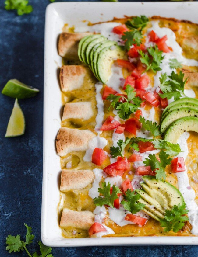 Honey Lime Chicken Enchiladas are a little bit sweet, a little bit spicy, and a whole lot of yummy! The chicken is marinated in a delicious honey lime mix, making the perfect base for these enchiladas. This easy chicken enchilada recipe is cheesy, flavorful, and fun. Try them out for your next dinner!