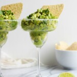 Guacamole Dip is a staple for game day, Cinco de Mayo, and summer parties. This delicious Margarita Guacamole Dip recipe is the perfect party dip, and it's so easy to make too. The secret? A bit of tequila mixed into the guacamole for an extra kick!