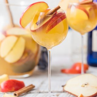 Apple Pie Sangria is light, refreshing, easy, and delicious! The hit of every party I take it to! Apple Cider, Caramel Vodka, White Wine, Ginger Ale, and more! The Cookie Rookie has Sangrias for every occasion!