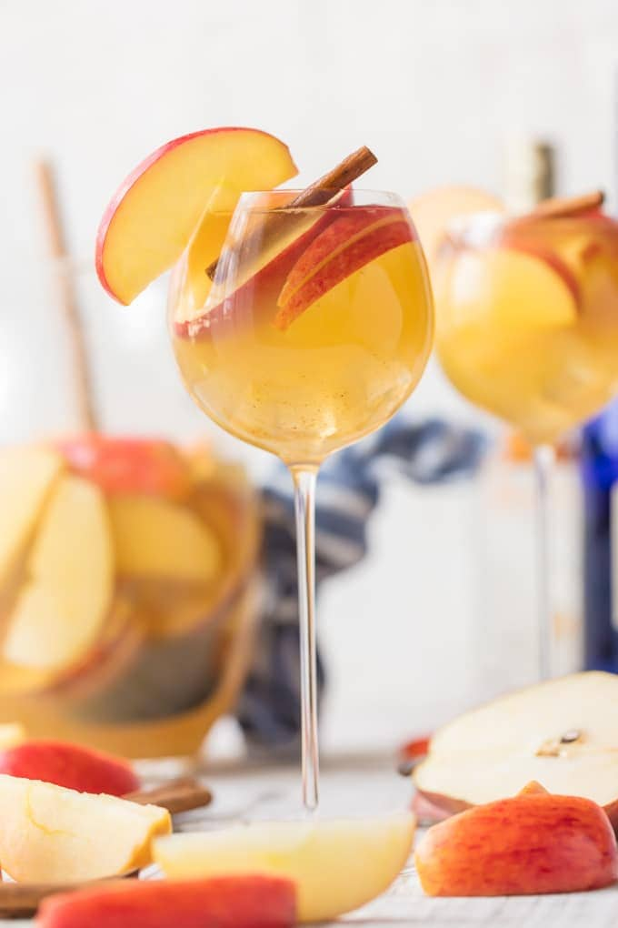 Caramel Apple Sangria in a tall wine glass