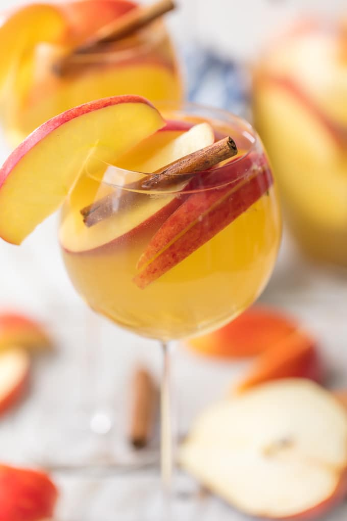 Apple Pie Sangria with apple slices and a cinnamon stick