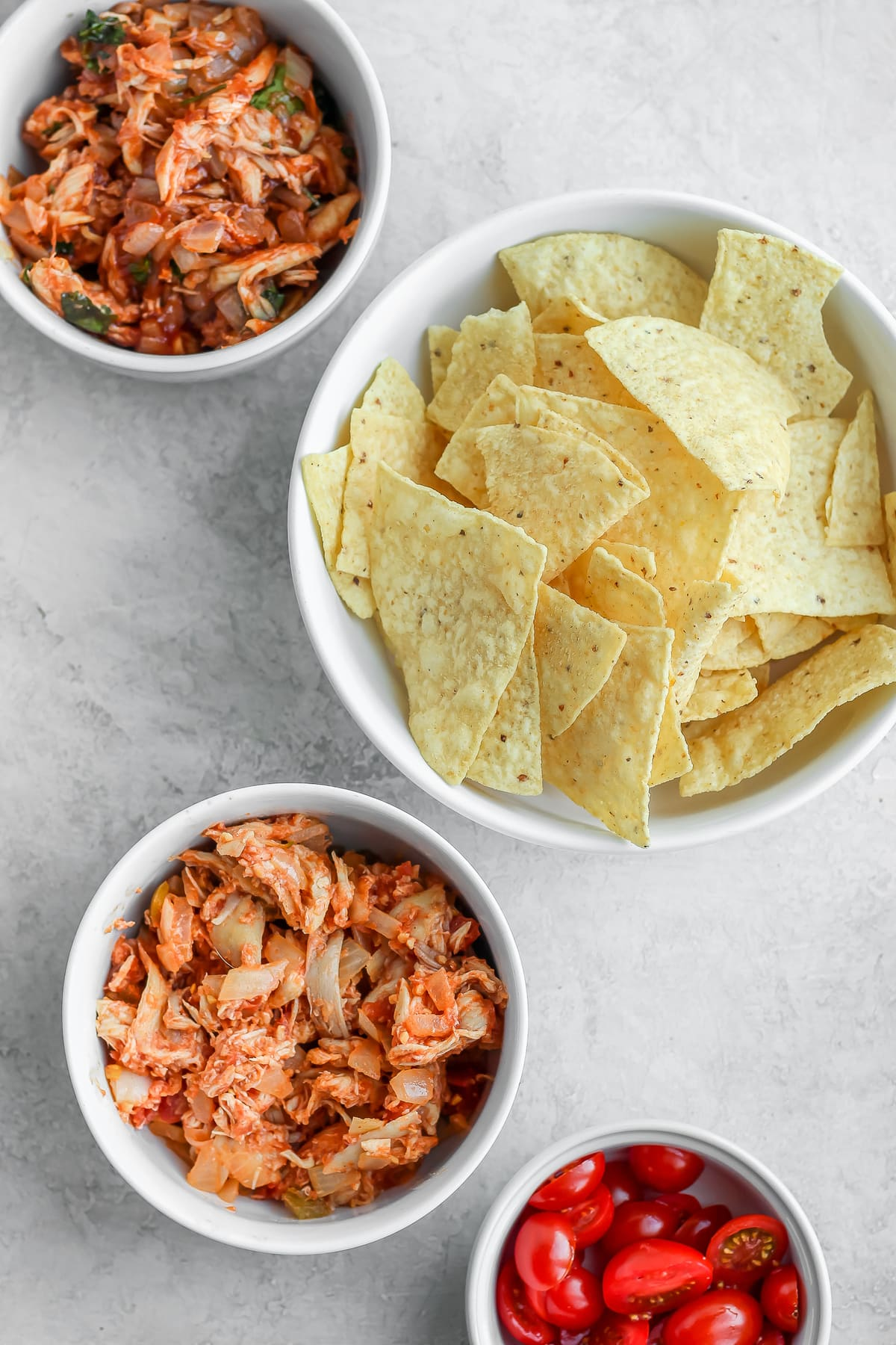 bowls filled with chips and shredded chicken