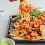 Grilled Chicken Nachos are a delicious and fun way to use your grill, even in the chillier months. Piled high with cheese and favorite toppings, the grilled smokey flavor will really surprise you! Choose from 2 flavors: BBQ Chicken Nachos or Mexican Nachos.