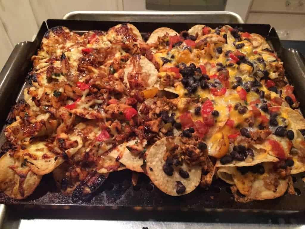 grilled chicken nachos on black grill pan