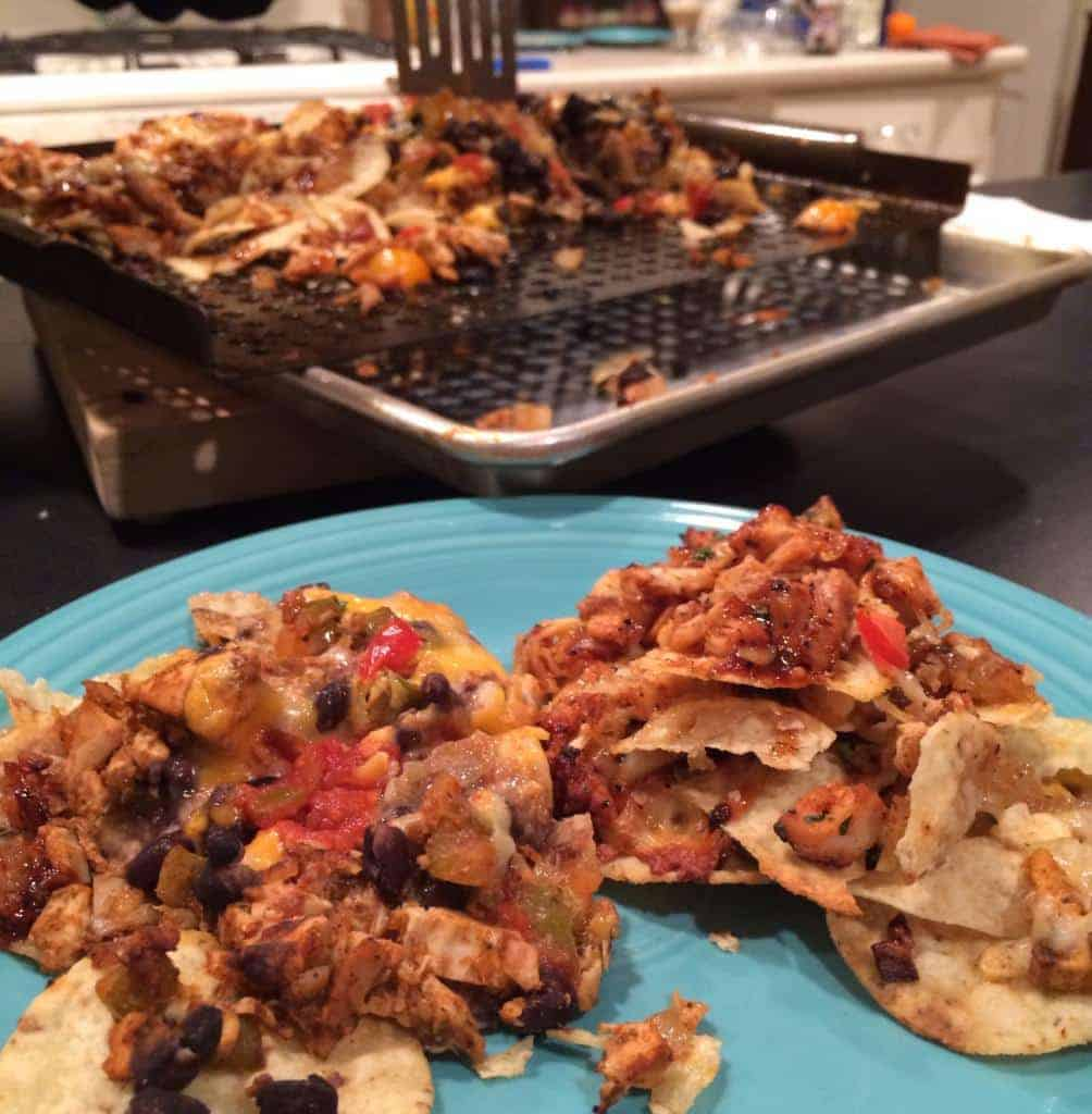 plate of grilled chicken nachos with grill tray in background
