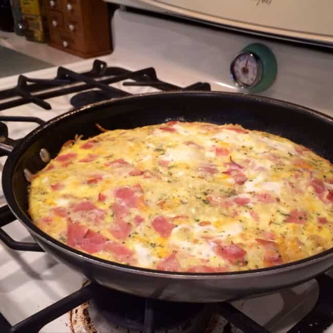 apple and gruyere frittata in skillet