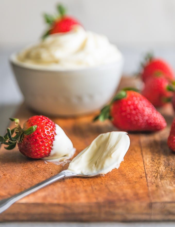 spoonful of mascarpone cheese with strawberries