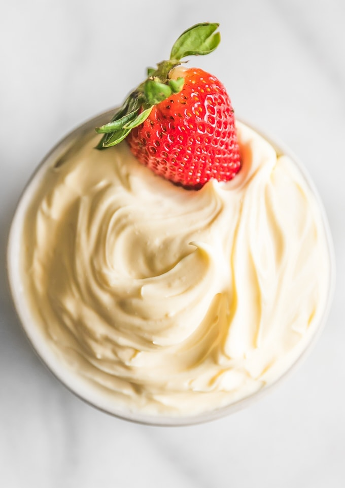 homemade mascarpone cheese with a strawberry