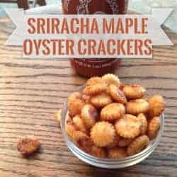 oyster crackers in front of a bottle of sriracha