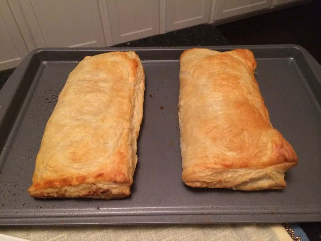 two chicken cordon bleu pockets on cookie sheet