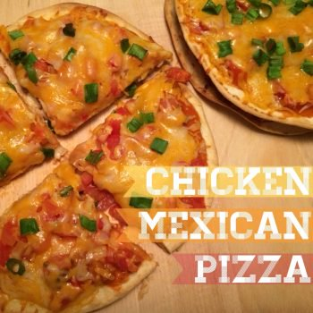 chicken mexican pizza sitting on wooden table