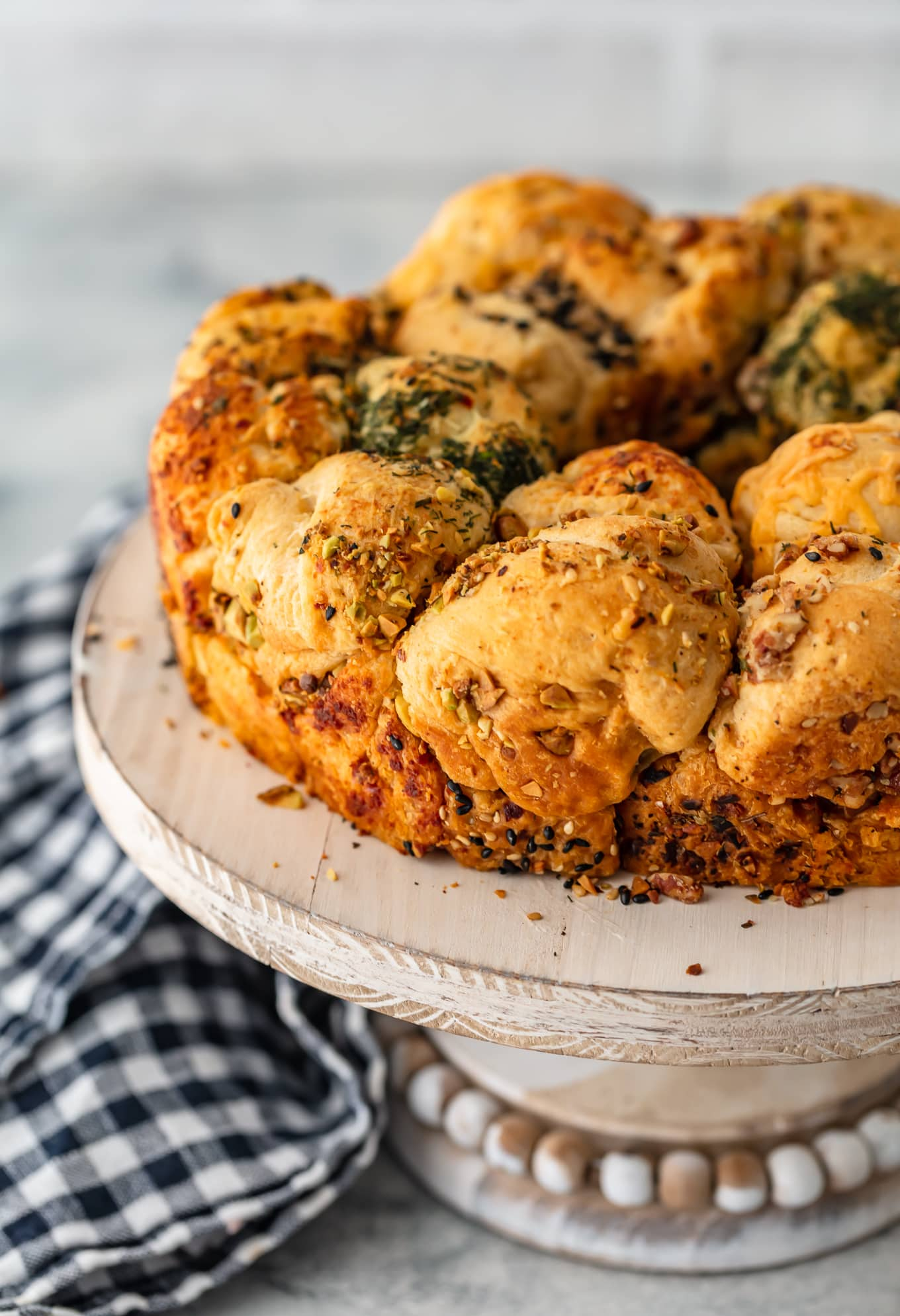 This Savory Monkey Bread recipe is flaky, flavorful and fun to eat. For an appetizer or a meal, it's a real crowd pleaser!
