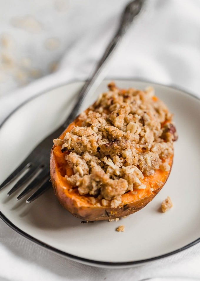 Half of a twice baked sweet potato on a white plate