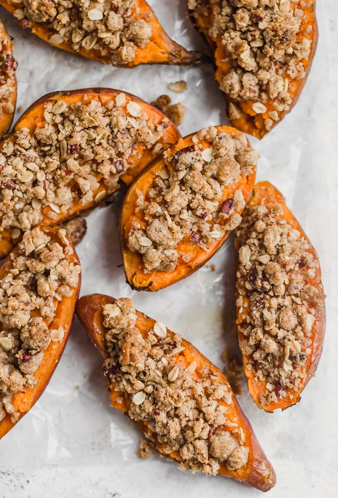 Twice baked sweet potatoes topped with a pecan, sugar, oatmeal, cinnamon mixture