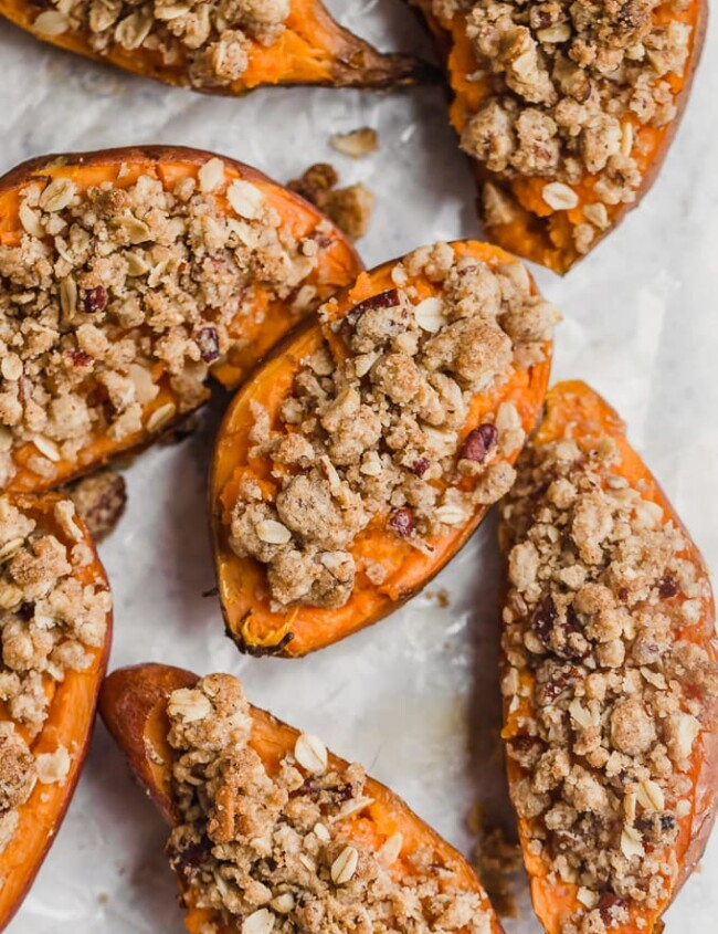 Twice Baked Sweet Potatoes are the perfect Thanksgiving sweet potato recipe! They're just like a regular twice baked potato, but they're topped with a pecan, cinnamon, oatmeal, and brown sugar mix to complement the natural sweetness. You'll definitely want this tasty sweet potato side dish on your holiday table!