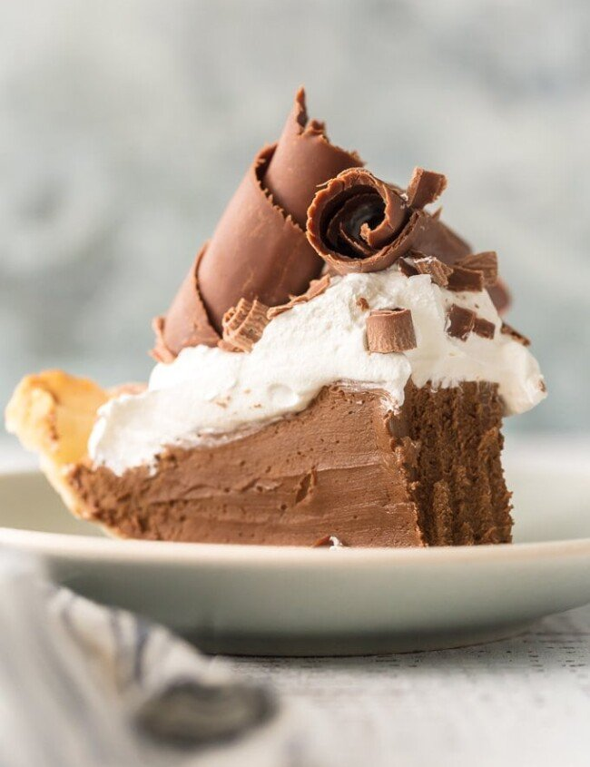 French Silk Pie is my all-time favorite pie recipe. This Chocolate Silk Pie is an easy version of a classic holiday favorite. We love this French Silk Pie at Thanksgiving, Christmas, Easter, my birthday, and every day in between. It tastes like chocolate mousse in pie form. Utterly decadent and delicious! Best French Silk Pie Recipe EVER!