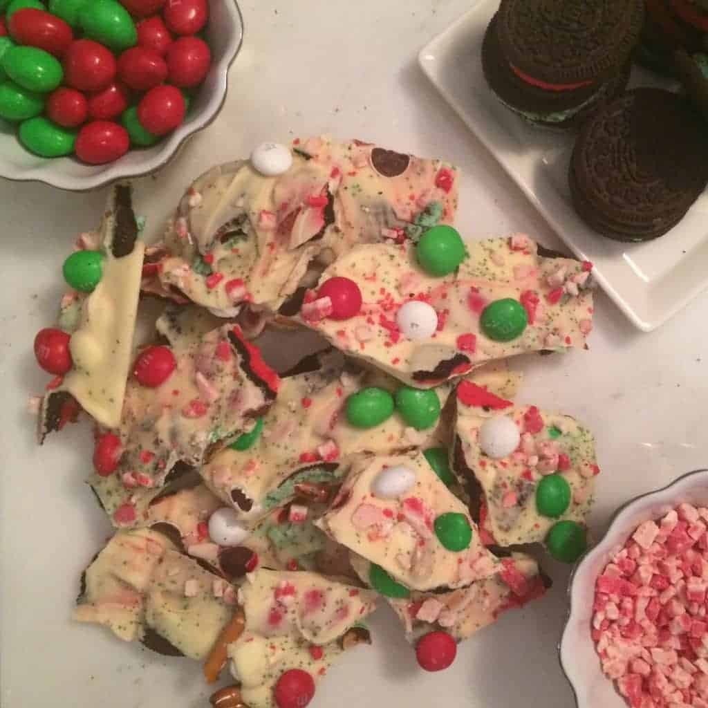 Christmas Bark surrounded by candies.