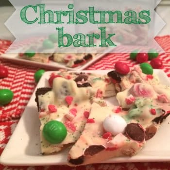 christmas bark on a white plate with candy around it