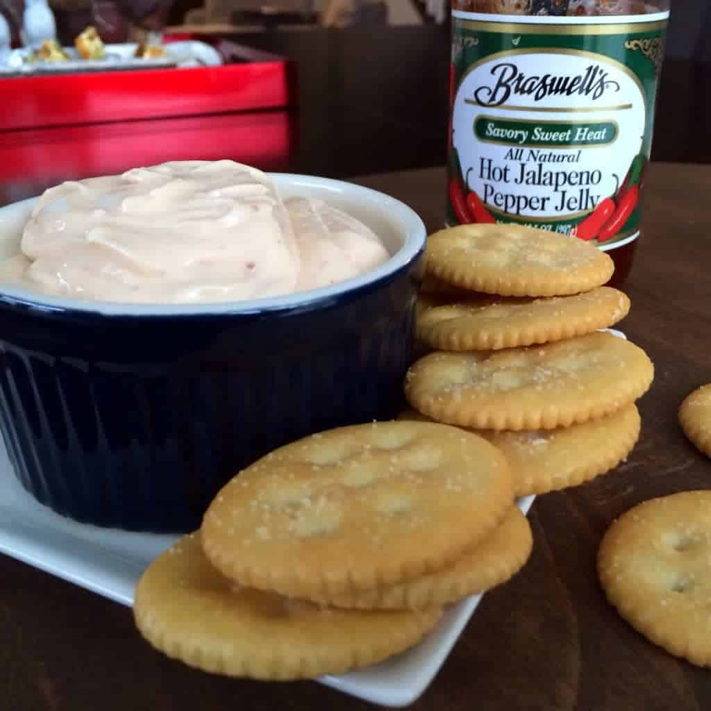 bowl of pepper jelly dip with crackers