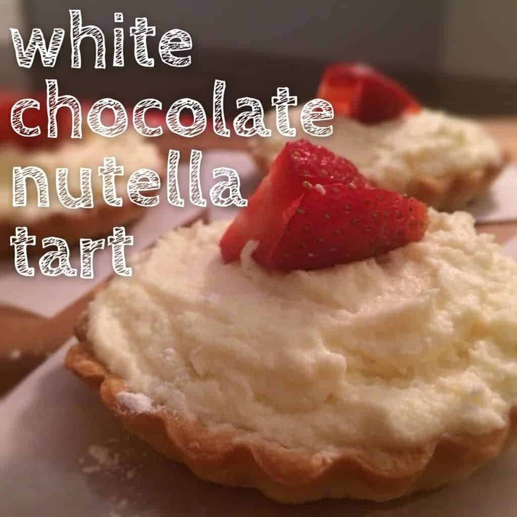 beautiful tarts made with white chocolate ganache and a layer of nutella. BE STILL MY HEART.