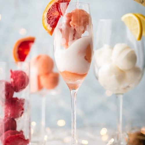 This is one of the BEST MIMOSA RECIPES for any brunch. It would even make a great dessert cocktail.  Sherbet Mimosas are a fun and creative way to dress up any mimosa recipe! Use the ice cream, sherbet, or sorbet flavor of your choice and mix with champagne. It's so fun, delicious, and beautiful! It's the perfect cocktail recipe to make for holidays, bridal showers, and beyond.
