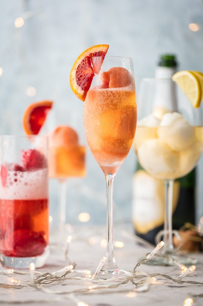 Sherbet Mimosas are a fun was to dress up any mimosa! Use the ice cream, sherbet, or sorbet flavor of your choice and mix with champagne. So fun, delicious, and beautiful! Perfect for holidays, bridal showers, and beyond.